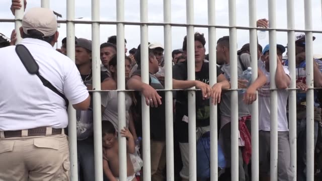 thousands of migrants wait on the bridge between guatemala and mexico for the mexican authorities to re open the border - guatemala stock videos & royalty-free footage