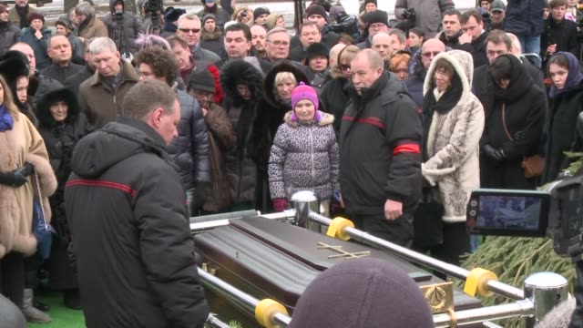 thousands of mourners on tuesday filed past the coffin of slain russian opposition leader boris nemtsov bidding farewell to a charismatic activist... - assassination stock videos and b-roll footage