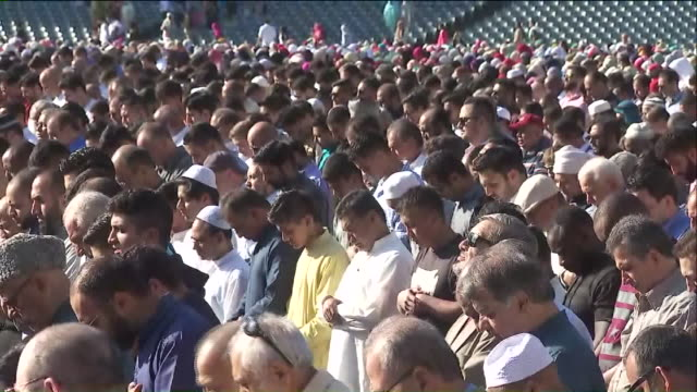 thousands of muslims gather at eid prayer celebration at angel stadium in ahaheim. - angel stadium stock videos & royalty-free footage