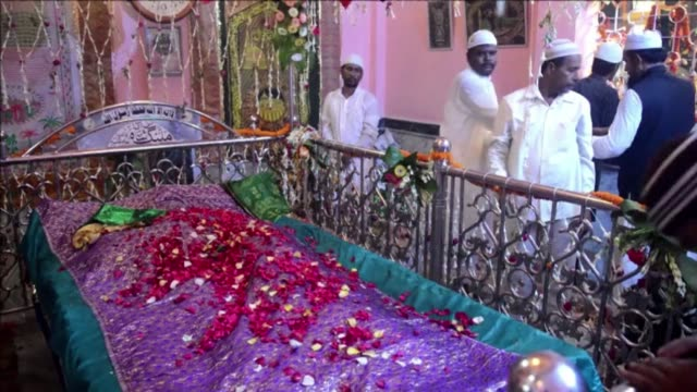 thousands of muslims pray at the malang shah baba darga shrine to pay tribute to the sufi saint during the annual urs religious festival in india - religious saint stock videos and b-roll footage