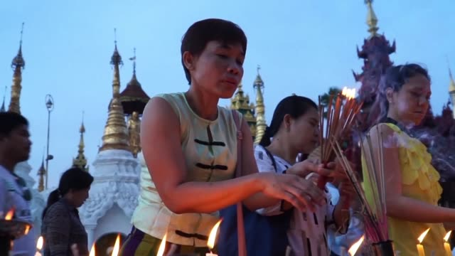 thousands of myanmar citizens come to pay their respects to buddha at yangon's shwedagon pagoda for the thadingyut festival of light - myanmar stock videos & royalty-free footage