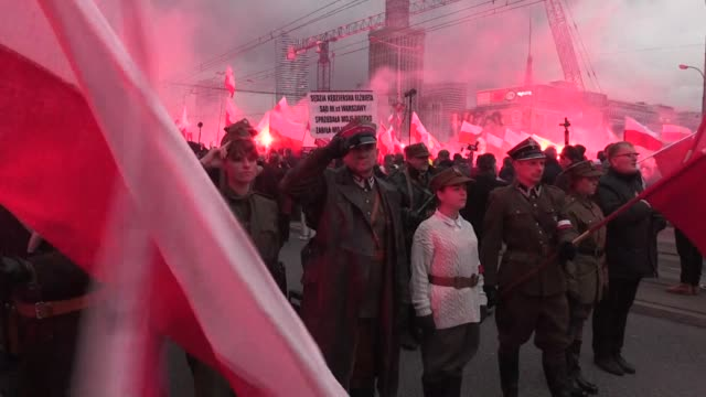 thousands of nationalists march in a demonstration organized by far right groups in warsaw as poland celebrates their independence day - poland stock videos & royalty-free footage