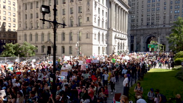 thousands of new york city students walk out of school to take part in a march to demand action on the global climate crisis on september 20 2019 in... - climate stock videos & royalty-free footage