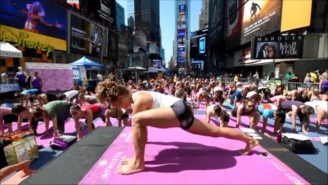 Thousands of New Yorkers took some time off to celebrate the first day of summer by taking part in mass outdoor yoga classes in Times Square the Big...