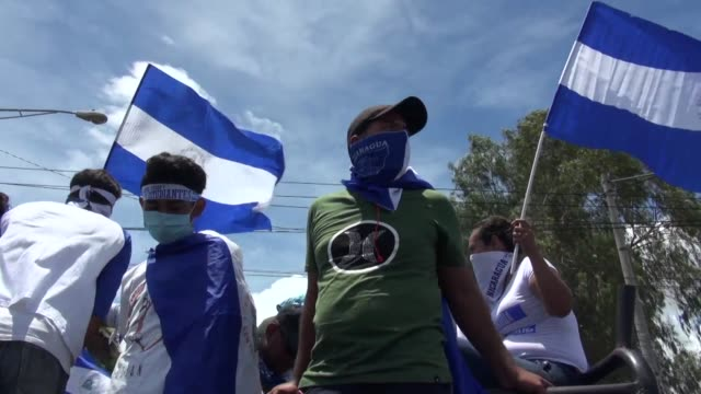 thousands of nicaraguans march through the streets of the capital managua demanding that president daniel ortega who has been in power for the last... - managua stock videos & royalty-free footage