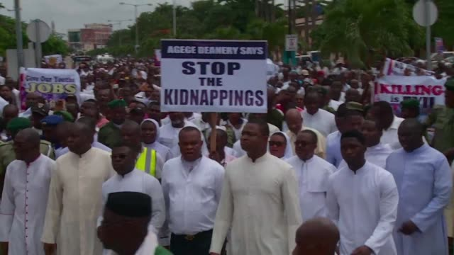 thousands of nigerian catholics took to the streets calling for an end to a spiral of violence between nomadic cattle herders and farmers - christianity stock videos & royalty-free footage