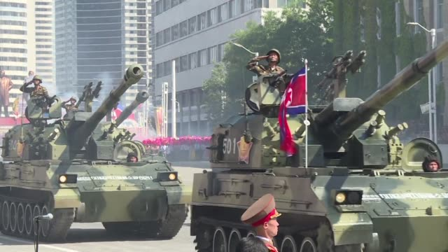 thousands of north korean troops parade through pyongyang as the nuclear armed country celebrates its 70th birthday followed by artillery and tanks - north korea stock videos & royalty-free footage