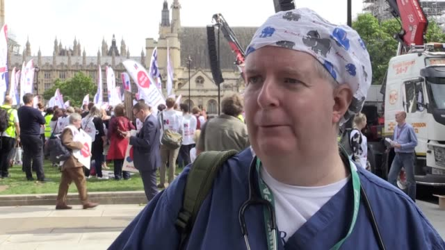 stockvideo's en b-roll-footage met thousands of nurses have gathered in london's parliament square to protest over a cap on pay nurses carrying placards and banners convened outside... - pet