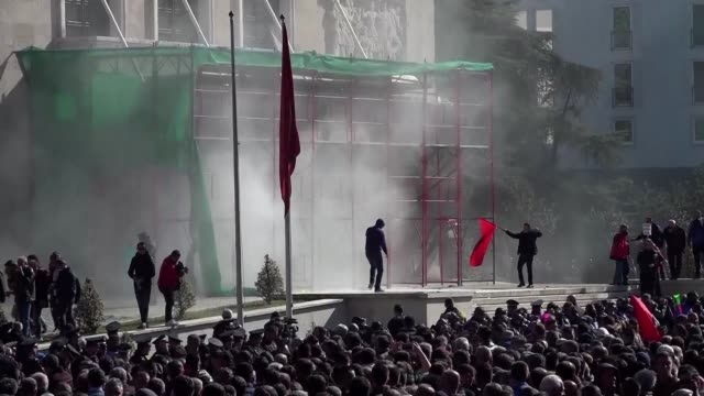 thousands of opposition supporters protest outside the albanian parliament demanding the resignation of prime minister edi rama and clash with police... - water cannon stock videos & royalty-free footage