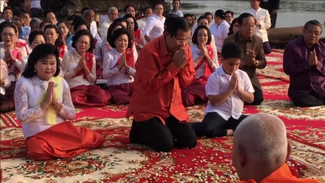 Thousands of orange clad monks join Cambodian Premier Hun Sen for a prayer ceremony by the famed Angkor temple lauding political stability after the...