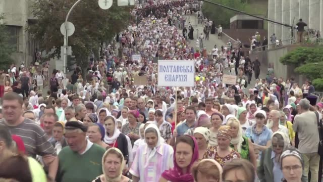 Thousands of Orthodox Christians process in Kiev to mark the anniversary of the conversion to Christianity in 988 of Kievan Rus the ancestor of...
