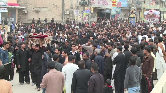 thousands of pakistani shiite muslims hold mourning processions to mark ashura amid tight security fearing of terror attacks on the 10th day of... - ashura muharram stock-videos und b-roll-filmmaterial