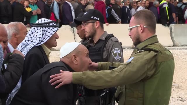 thousands of palestinians from the west bank cross into jerusalem on their way to al-aqsa mosque for the first friday prayers of the holy fasting... - palestinian stock videos & royalty-free footage