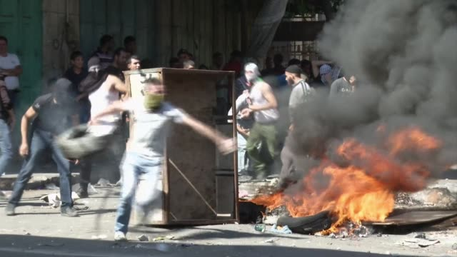 stockvideo's en b-roll-footage met thousands of palestinians in the gaza strip the west bank and east jerusalem demonstrated friday to mark the anniversary of an uprising against... - oost jeruzalem