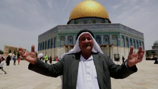 thousands of palestinians pray in front of the dome of the rock mosque in the al aqsa mosque compound in the old city of jerusalem as they... - compounding stock videos and b-roll footage