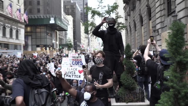 thousands of peaceful young blm protesters march from bryant park to trump tower, in front of saks fifth ave, shout 'black lives matter', 'fuck... - bryant park stock videos & royalty-free footage