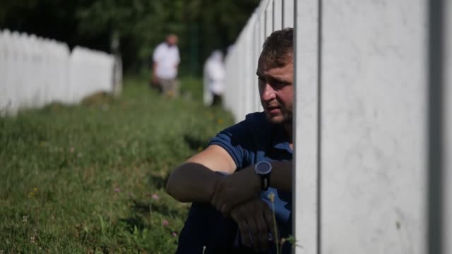 thousands of people are beginning to gather at a memorial center and cemetery in potocari, eastern bosnia, to mark the 22nd anniversary of the 1995... - bosnia and hercegovina stock videos & royalty-free footage