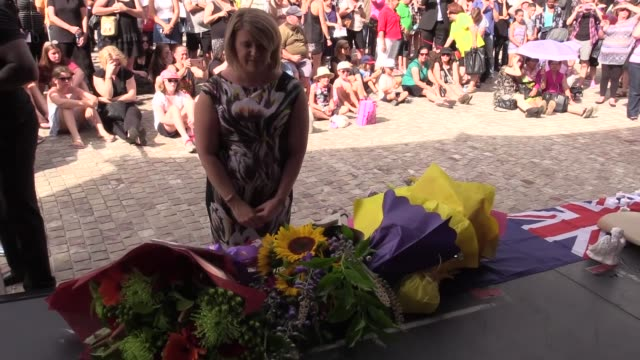 Thousands of people attend a vigil at Federation Square to pay tribute to the victims of the Bourke Street Mall rampage in Melbourne Victoria...