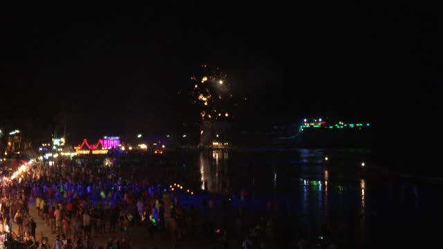 thousands of people attend the full moon party on the beach on ko phangan in thailand on jan 4 2015 - ko phangan stock videos and b-roll footage