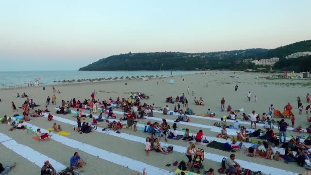 thousands of people bring their dinner on improvised table of the longest dinner on the beach on the asparuhovo beach in the black sea town of varna... - bulgaria stock videos & royalty-free footage