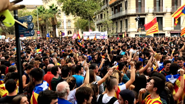 Thousands of people chant slogans as they gather outside the General Direction of the National Police of Spain building to protest against the...