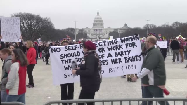 vídeos de stock, filmes e b-roll de thousands of people dominated by women protest us president donald trump in washington united states on january 21 2017 - 2017