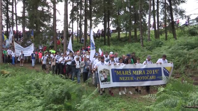 thousands of people from all over the world set off for a threeday peace march in bosnia and herzegovina to commemorate the 24th anniversary of the... - srebrenica stock videos and b-roll footage