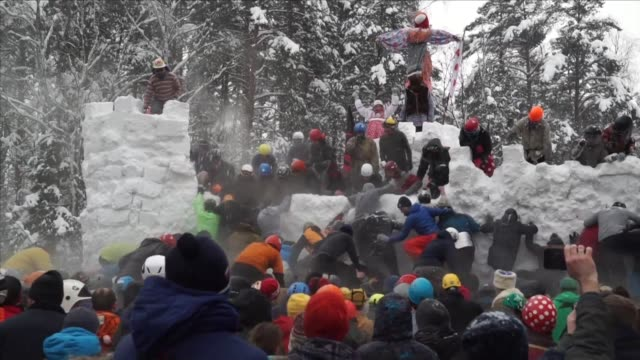 Thousands of people gather in a snowy forest outside Moscow to celebrate the Eastern Slavic religious and folk holiday Maslenitsa