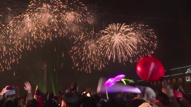 thousands of people gather in a square in the north korean capital to watch dazzling fireworks and a concert as the country rings in the new year - korean new year stock videos & royalty-free footage