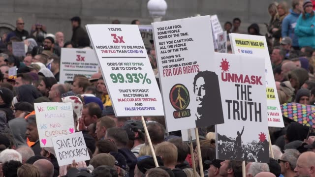 thousands of people gather on trafalgar square for a coronavirus conspiracy protest on september 26, 2020 in london, england. the protest not only... - conspiracy stock videos & royalty-free footage