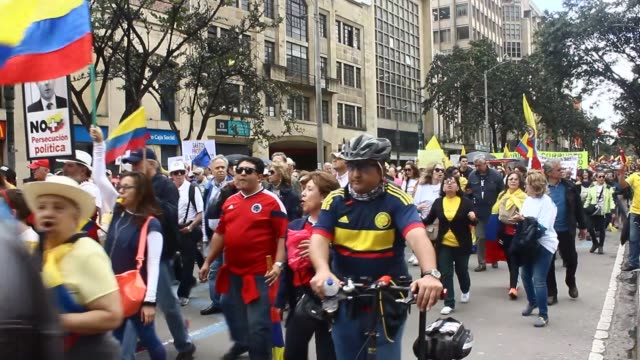 thousands of people gather to protest corruption and the colombian government at demonstration in bogota colombia on april 01 2017 protestor also... - peace demonstration stock videos and b-roll footage