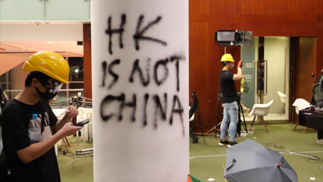 thousands of people gather to protest the handover flag raising ceremony outside the legislative council offices in hong kong. protesters occupied... - hong kong stock videos & royalty-free footage