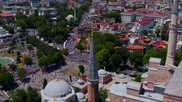 thousands of people gathered around hagia sophia on friday to attend the first friday prayer ahead of historic building's reopening for worship for... - istanbul province stock videos & royalty-free footage