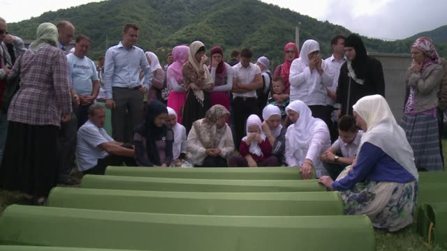 thousands of people gathered on friday in srebrenica to mark the 19th anniversary of the massacre of some 8000 muslim males by ethnic serb forces... - srebrenica stock videos and b-roll footage