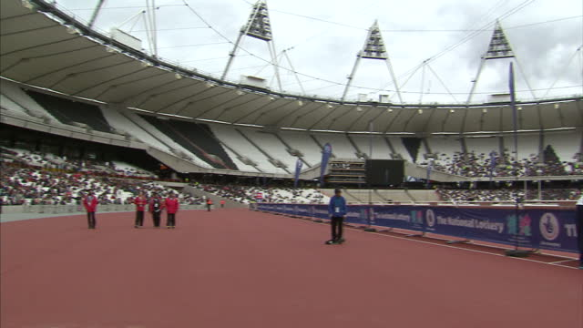 voiced thousands of people have crossed the finish line at london's olympic stadium for the first time the run was part of a test ahead of the games... - summer olympic games stock videos and b-roll footage
