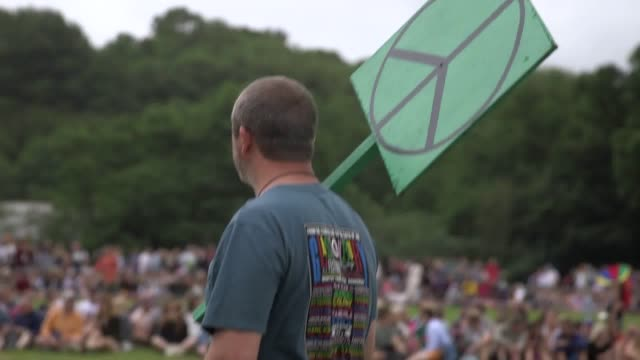 Thousands of people have joined together to create the largest human peace sign at Glastonbury Festival Organisers estimate that up to 15000...