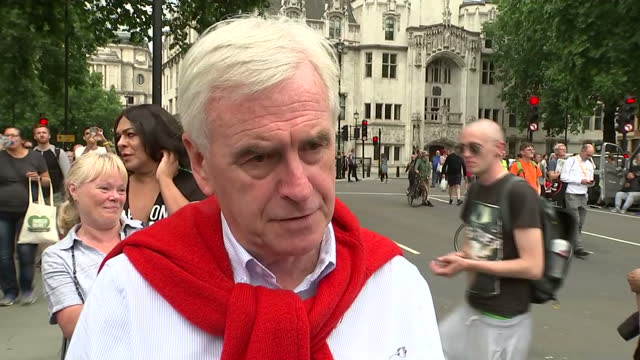 thousands of people have protested in london against the tory government's spending cuts among them john mcdonnell labour shadow chancellor of the... - chancellor of the exchequer stock videos and b-roll footage