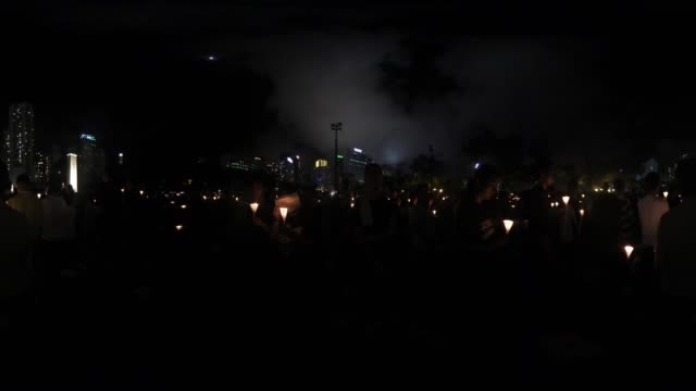 thousands of people in hong kong participated in an annual candlelight vigil in hong kong on june 4 to commemorate the killing of protesters in... - tiananmen square massacre stock videos & royalty-free footage
