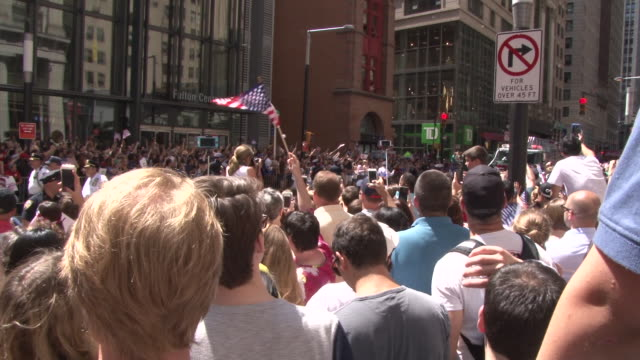 Thousands of people line Broadway in Downtown Manhattan otherwise known as the Canyon Of Heroes during a Ticker Tape Parade celebrating the World Cup...
