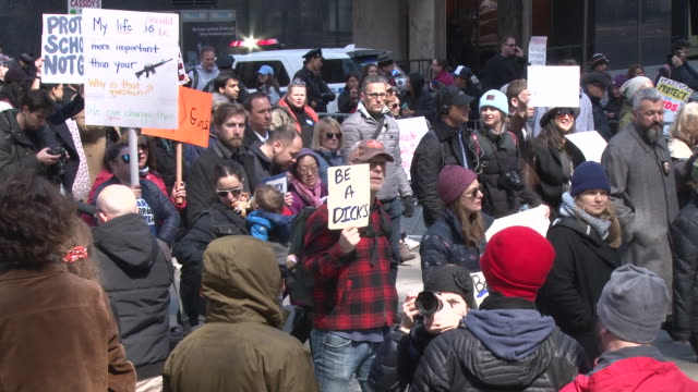 thousands of people many of them students march against gun violence in manhattan during the march for our lives rally on march 24 2018 in new york... - march for our lives stock videos and b-roll footage