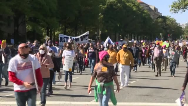 thousands of people march down pennsylvania avenue in washington dc heading to the supreme court to protest trump's nominee to the high court amy... - pennsylvania avenue video stock e b–roll