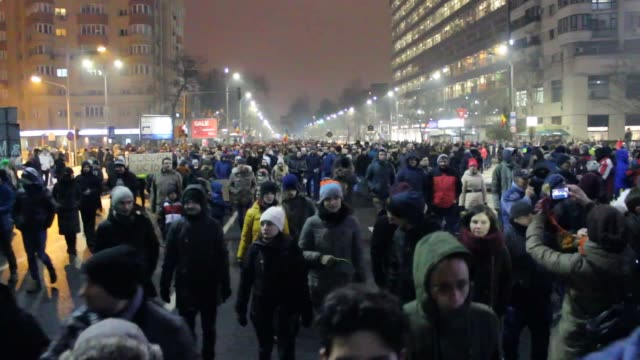 Thousands of people march during a rally to protest a government proposal to pardon thousands of prisoners on January 22 2017 in Bucharest Romania