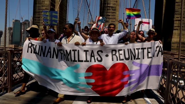 thousands of people march in support of families separated at the u.s.-mexico border on june 30, 2018 in new york, new york. across the country... - divisione video stock e b–roll