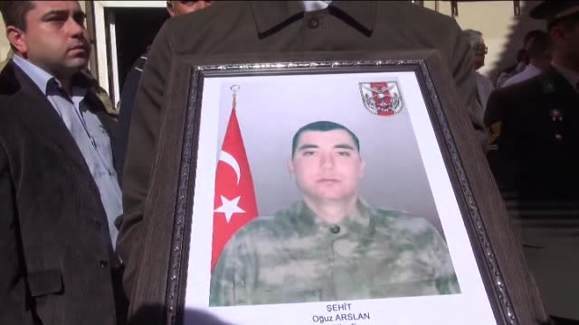thousands of people march with honour guards as they carry the coffin of martyred turkish soldier oguz arslan who was critically wounded in a pkk... - aydın province stock videos and b-roll footage