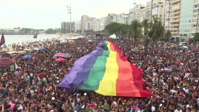thousands of people marched danced and celebrated in rio de janeiro's gay pride parade on sunday packing copacabana beach despite the ultra... - pride stock videos & royalty-free footage