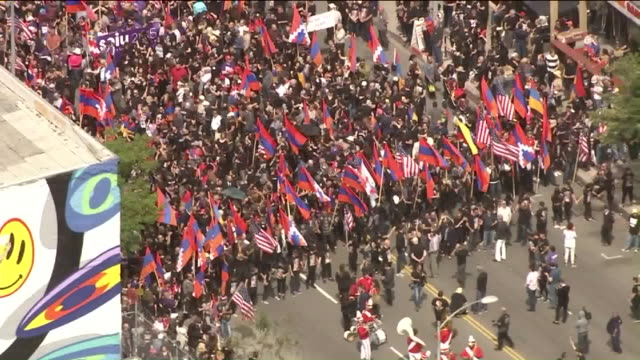 thousands of people marched in los angeles monday to mark the 102nd anniversary of the 1915 armenian genocide. - eastern european culture stock videos & royalty-free footage
