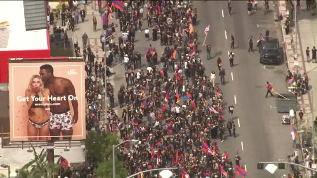 vídeos de stock e filmes b-roll de thousands of people marched in los angeles monday to mark the 102nd anniversary of the 1915 armenian genocide. - cultura da europa de leste