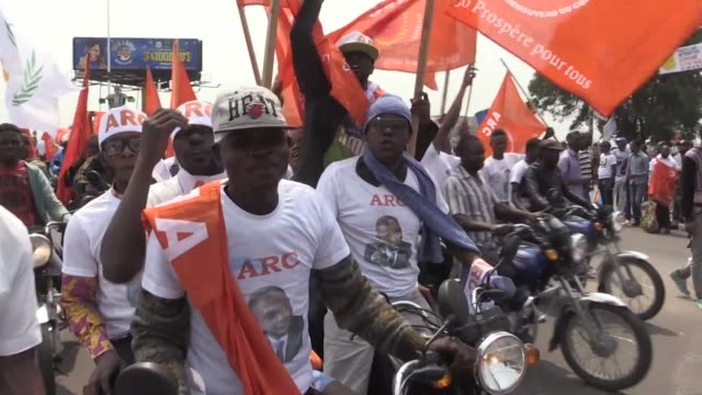 thousands of people rally in kinshasa in support of the countrys opposition leader etienne tshisekedi who recently returned to the democratic... - democratic republic of the congo stock videos & royalty-free footage
