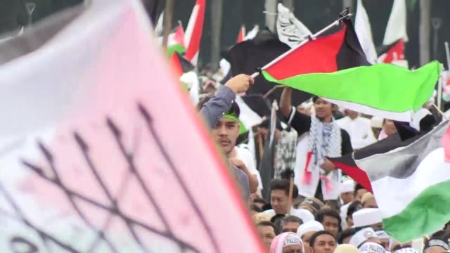 Thousands of people take part in a mass rally to support Palestine against US policy at National Monument Complex in Jakarta Indonesia on December 17...