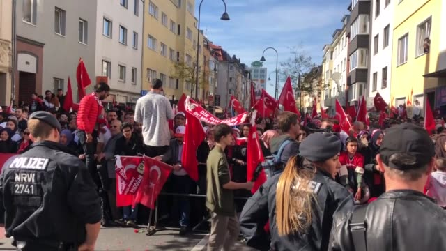 thousands of people wait for the arrival of turkish president recep tayyip erdogan near the ditib cologne central mosque and complex on september 29... - moschea video stock e b–roll
